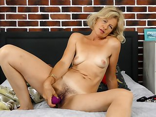 Diana Gold fucks her hairy cunt relative to a mating toy and moans uncontrollably